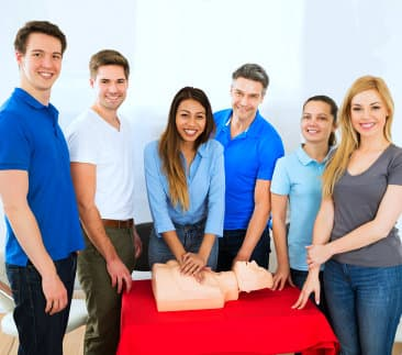 a group of students performing cpr trainig
