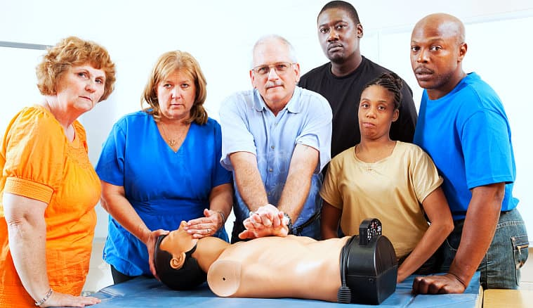 a group of people in a cpr training