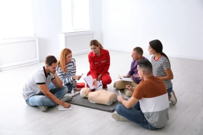 group of people with instructor at first aid class